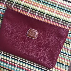 Bric's red leather cosmetic case for travel pouch